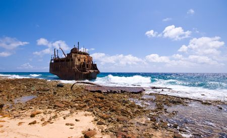 perish: rusty caribbean shipwreck washing ashore