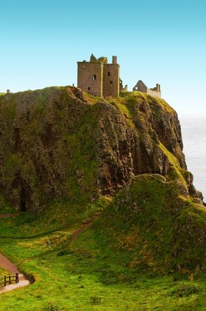 dunnottar castle on a cliff vovered with grass