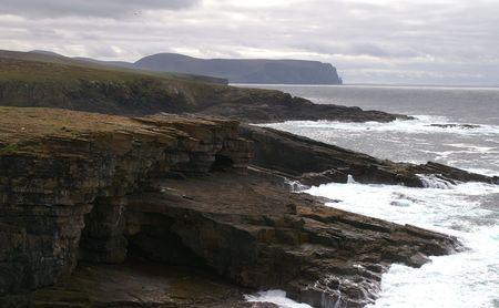 inlet bay: coastal cliffs on a dark cloudy day