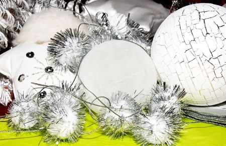 forground: white and silver  christmas decoration on green forground  Stock Photo