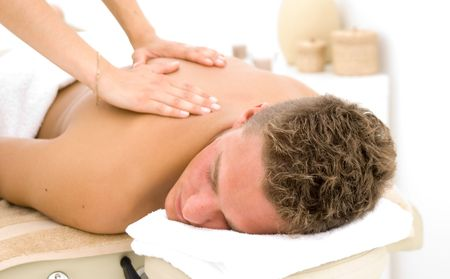 young man in a spa getting a massage Stock Photo