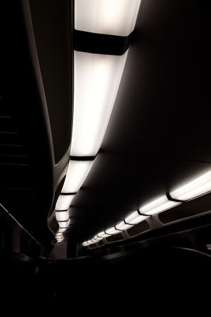 lights inside a train dark and almost black and white