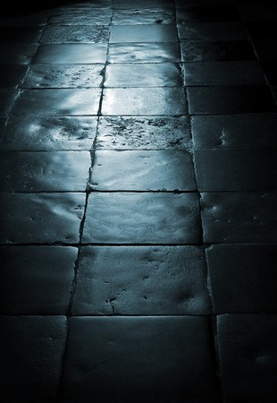 old tile floor with blue light shining on it  Stock Photo