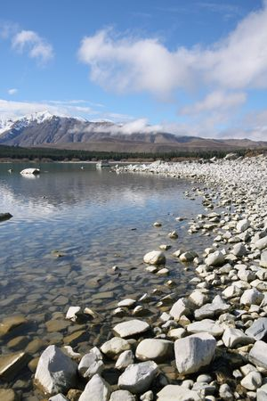 tekapo: Rocky shore of Lake Tekapo New Zealand