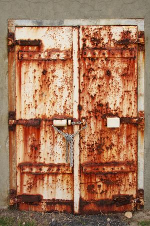 padlocked: Old rusted doors chained and padlocked shut