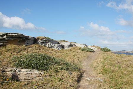 Narrow coastal path on clear sunny day photo