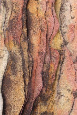 ridged: Close up of colorful ridged sandstone texture Stock Photo