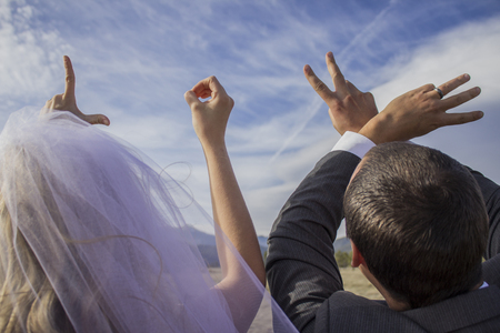Bride and groom spelling out love