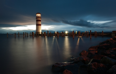 Lighthouse at Lake Neusiedl at cloudy night photo