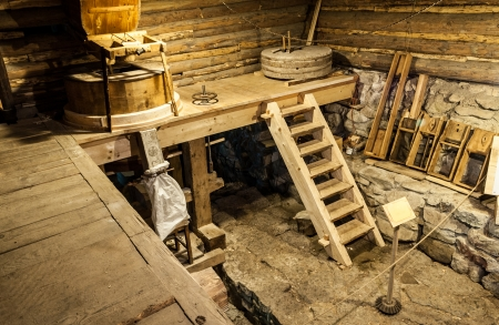millstone: wooden mill inside with equipment
