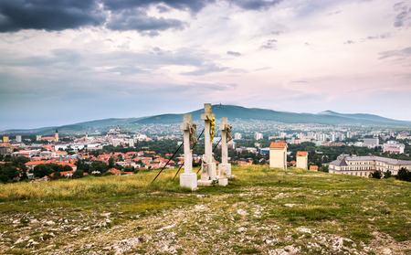 tortured: Jesus Christ Cross on Calvary with City of Nitra and Zobor Mountain in Background