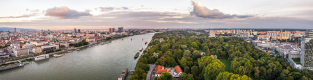 right bank: Danube River in City of Bratislava. Petrzalka Suburb on the Right Bank of the River at Sunset