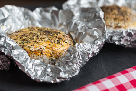 aluminum foil: Grilled Camembert Cheese with Spices in Aluminum Foil Stock Photo