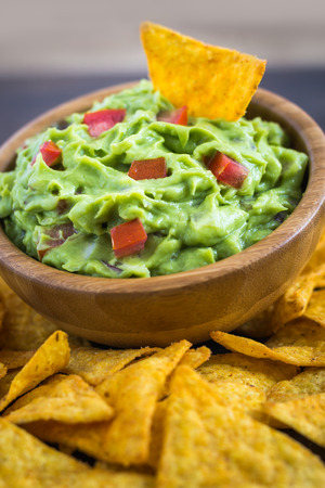 tortilla chips: Guacamole in Wooden Bowl with Tortilla Chips