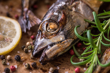 Roaster: Baked Fish with Spice, Lemon and Rosemary on a Roaster Pan with Baking Paper