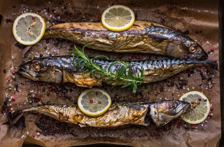 Roaster: Baked Whole Fish with Spice, Lemon and Rosemary on a Roaster Pan with Baking Paper