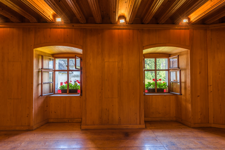 open windows: Open Windows with Flowers in Empty Wooden Room Stock Photo