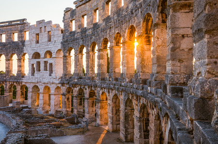 roman amphitheater: Architecture Details of the Roman Amphitheater Arena in Sunny Summer Evening. Famous Travel Destination in Pula, Croatia. Stock Photo