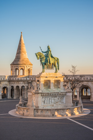 halaszbastya: Saint Stefan Statue at Fishermans Bastion, in Budapest, Hungary with Clear Blue Sky in Background at Sunrise