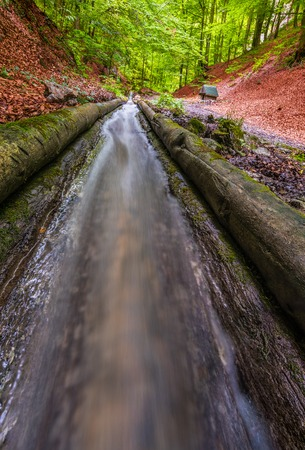 2 5: Closeup of Flowing Water in Water Channel in the Valley of Rakytovo, Harmanec, Slovakia. Built in 19th Century 2,5 km Long Unique Technical Monument for Delivering Wood from Forest with Help of Regulated Water. Stock Photo