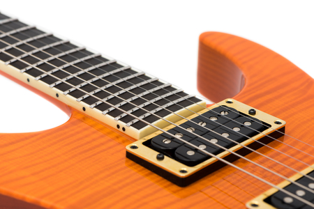 with orange and white body: Detail of Orange Electric Guitar Body with Strings Isolated on White Background Stock Photo