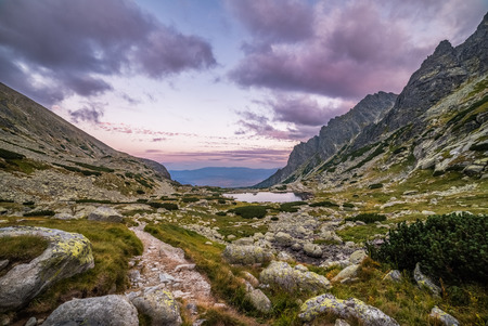 Mountain Landscape with a Tarn and Rocks in the Evening. Mlynicka Valley, High Tatra, Slovakia.