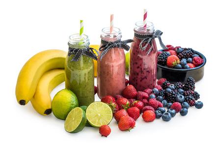 rainbow cocktail: Smoothies with Fresh Fruit Isolated on White Background Stock Photo