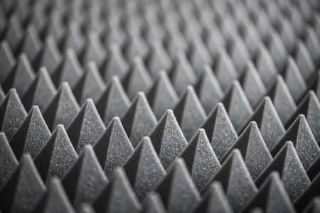 dampen: Close up of Sound Absorbing Sponge in Recording Studio. Dampening Acoustical Foam in Music Studio. Acoustic Foam Detail.