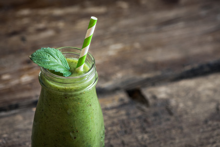 Fresh Green Smoothie on Rustic Wood Stock Photo