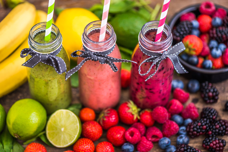 rainbow cocktail: Healthy Fresh Smoothies and Fruit on Rustic Wooden Background