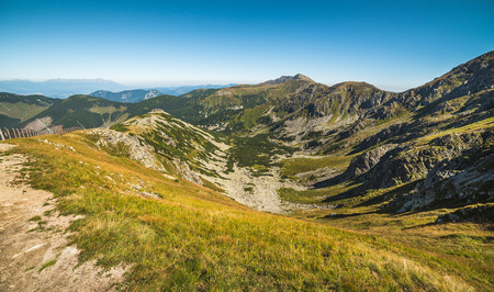 Way Up to Top of Chopok Mount in Low Tatras National Park, Slovakia. High Tatras in Background. Mountain Landscape. Stock Photo