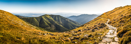 long way: Rocky Hiking Trail in the Mountains on Sunny Day. Low Tatras Ridge, Slovakia. Stock Photo