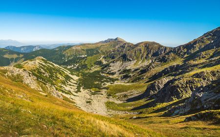 Valley and Mountain Landscape. Under Chopok Mount with Dumbier Mount in Background. Low Tatras, Slova. Reklamní fotografie - 69452148