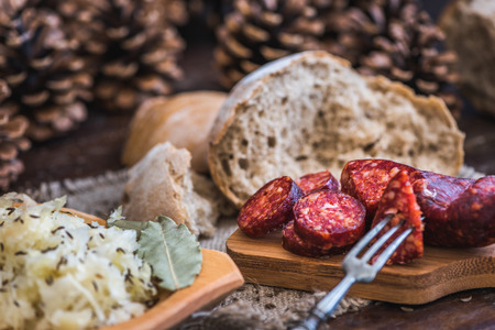 Farmers Breakfast. Sausage, Sour Cabbage and Bread. Raw Ingredients.