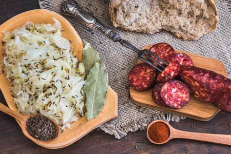 Farmers Breakfast. Sausage, Sour Cabbage and Bread. Raw Ingredients and Seasoning.