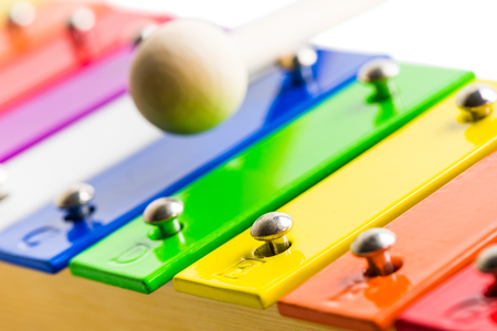 xilofono: Closeup Detail od Rainbow Colored Wooden Xylophone Isolated on White Background