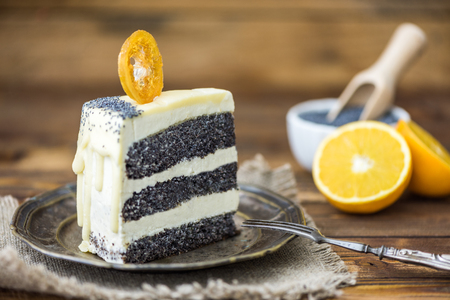 Piece of a Poppy Seed Cake with Caramelised Orange on an Old Metalic Plate