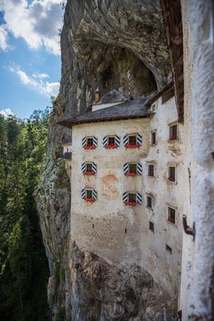 Detail of Renaissance Castle Built Inside Rocky Mountain in Predjama, Slovenia. Famous Tourist Place in Europe. Castle Window View.