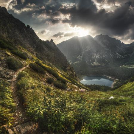 Mountain Landscape with Poprad Mountain Lake, High Tatras, Slovakia at Sunset Stock Photo