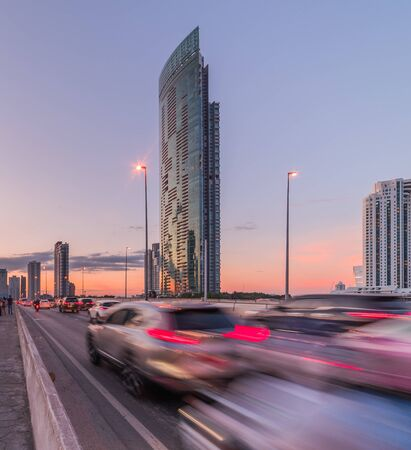 Skyscrapers and Traffic on Taksin Bridge in Bangkok, Thailand at Sunset
