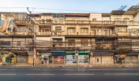 Typical Residential Street Scene with Housing and Shops with Lot of Cabling on Charoen Krung Road Banco de Imagens