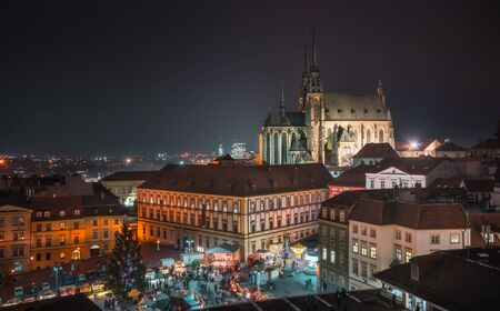 Old Town with Christmas Market and Cathedral of St. Peter and Paul in Brno, Czech Republic as Seen from City Hall Tower at Night