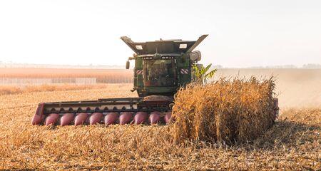 Combine Harvester Machine Finishing Work on Agricultural Corn Field Reklamní fotografie