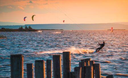 Kite Surfer at Neusiedl Lake in Podersdorf, Austria at Sunset Stock Photo