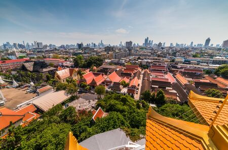 Traditional Thai Architecture with Modern Buildings and Skyscrapers in Background. Cityscape of Bangkok, Thailand as Seen from Temple of the Golden Mount (Wat Saket).