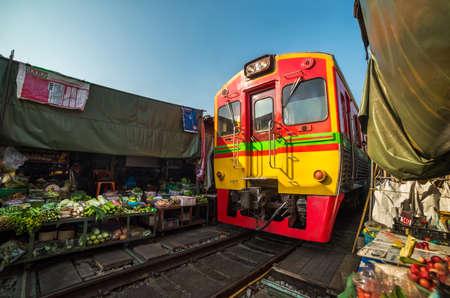 Umbrella Fresh Market on the Railroad Track, Mae Klong Train Station, Bangkok, Thailand on a Sunny Day