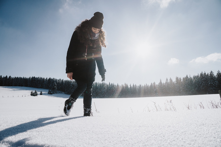 Snowroad young woman walking through winter scenery in the Thuringian Forest in Germany Stock Photo