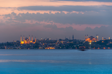 Istanbul, Turkey, 11 June 2007: Sunset of The Hagia Sophia and Suleymaniye.