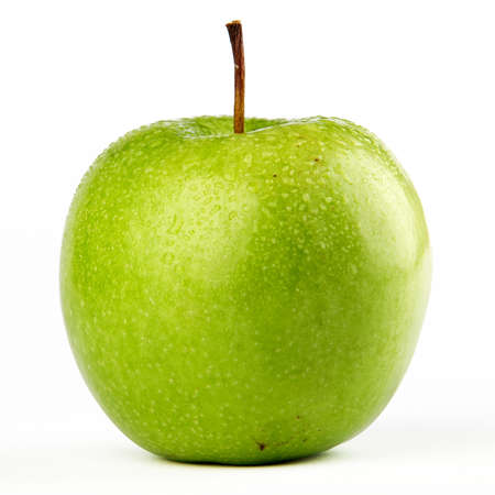 A full isolated view of a fresh green apple with dew drops on top photo