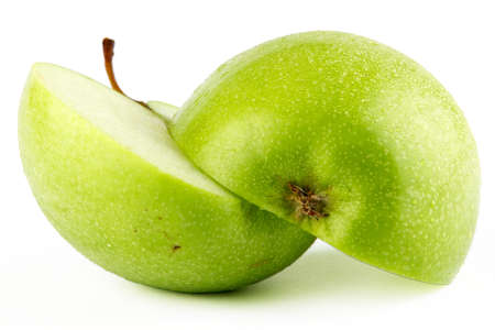 A full isolated view of a fresh green apple sliced and with dew drops on top photo